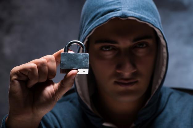 computer-hacker-working-dark-room_85869-8173